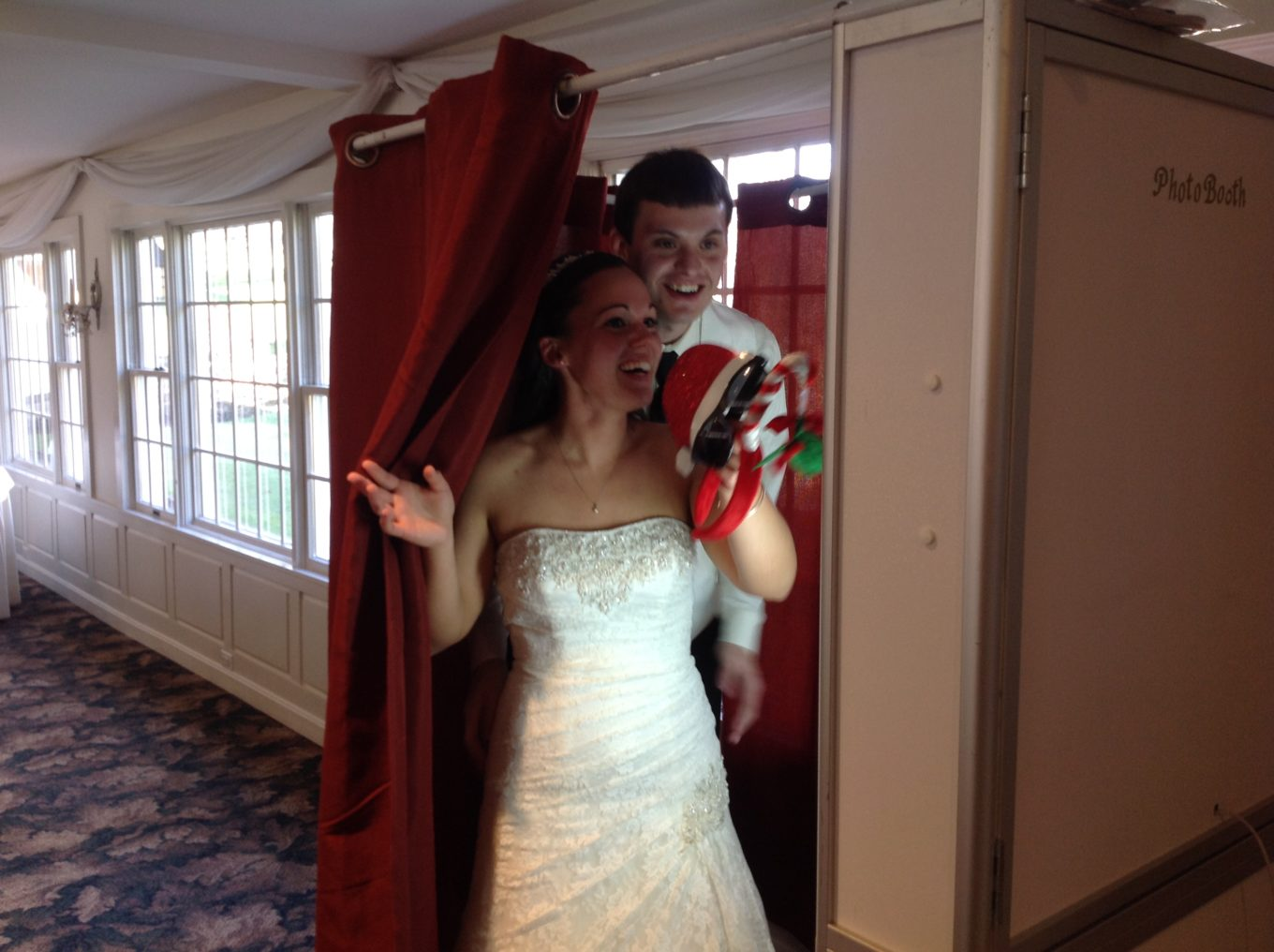 bride and groom stepping into the photo booth